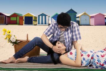Man fondle his girlfriend at beach