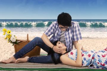 Romantic chinese couple at coast