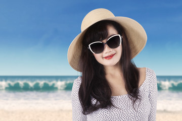 Pretty girl with sunglasses at coast