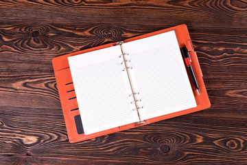 Open notebook on the table.