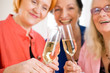 Smiling Mom Friends Tossing Glasses of Champagne. - 81782988