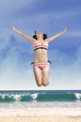 Woman wearing swimwear enjoy freedom
