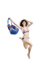 Woman with swimwear jumping in studio