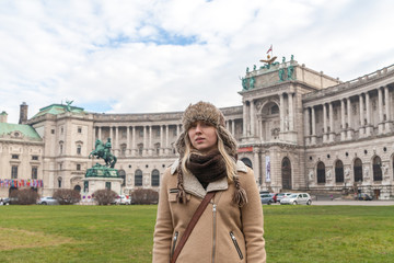 The girl on the background of the Hofburg Palace, Vienna