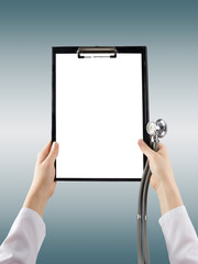 Female doctor's hand holding blank medical clipboard and stethos