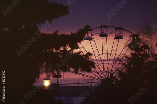 canvas print picture Ferris wheel at sunset