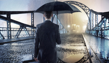 Elegant man holding an umbrella