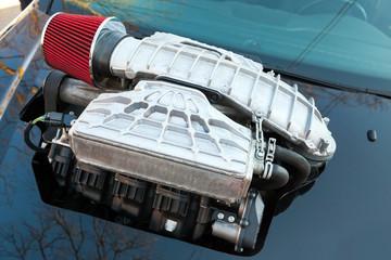 Supercharger, air compressor on a car hood