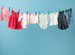 Wet baby's clothes getting dry - 81784940