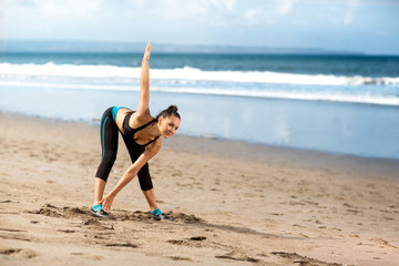woman doing exercises warming up before jog
