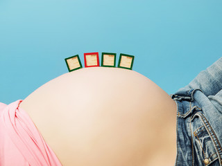 Letter boxes on pregnant woman's belly