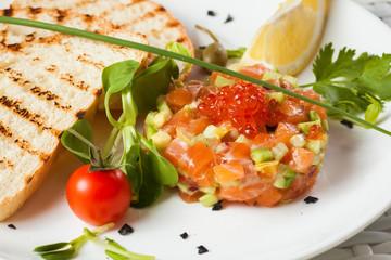 Salmon Tartar on a light background. Starter close up