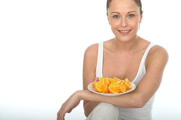 Attractive Young Woman Holding a Plate of Cut Oranges