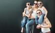 Happy family on black studio background