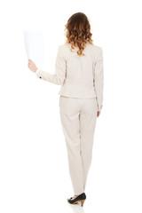 Businesswoman holding a paper sheet.