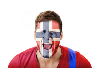 Screaming man with Norway flag on face.