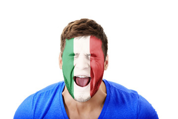 Screaming man with Italy flag on face.