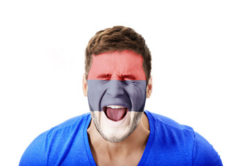 Screaming man with Serbia flag on face.