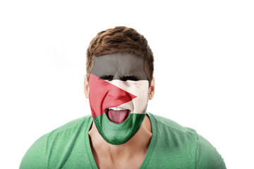 Screaming man with Palestine flag on face.