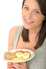 Young Woman Holding a Typical Healthy Norwegian Breakfast
