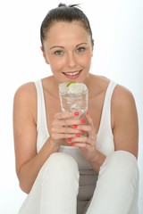 Healthy Attractive Young Woman Holding a Glass of Iced Water