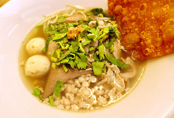 Clear soup with minced pork and vegetable