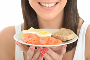 Healthy Happy Young Woman Holding a Plate of Norwegian Style Bre
