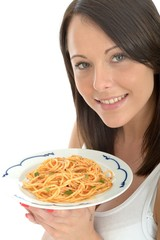 Attracrtive Young Woman Holding a Plate of Spaghetti Pasta