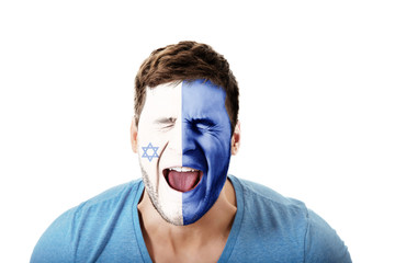 Screaming man with Israel flag on face.
