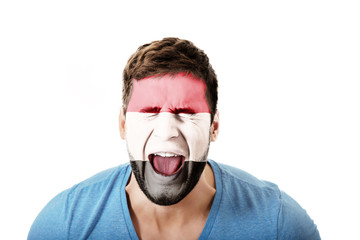 Screaming man with Egypt flag on face.