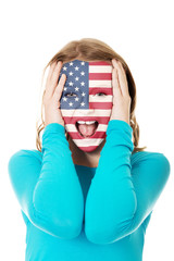 Woman with usa flag on face.