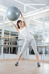 Woman in the gym with ball