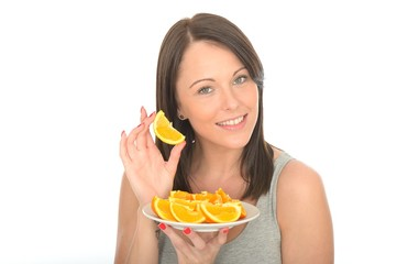 Attractive Young Woman Holding a Plate of Sliced Oranges