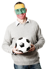 Mature man with Lithuania flag on face.