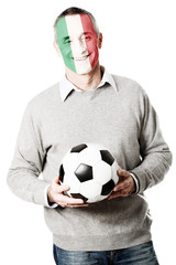 Mature man with Italy flag on face.