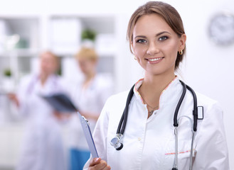 Portrait of woman doctor at hospital with folder