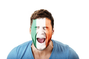 Screaming man with Ireland flag on face.