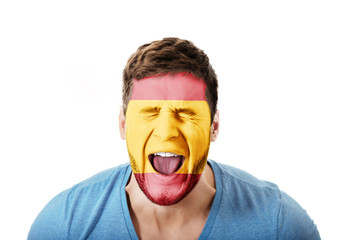 Screaming man with Spain flag on face.