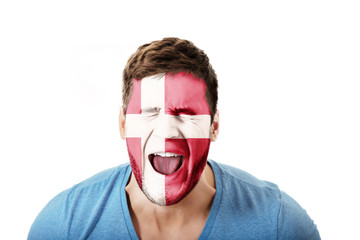 Screaming man with Denmark flag on face.