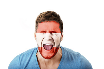 Screaming man with Austria flag on face.