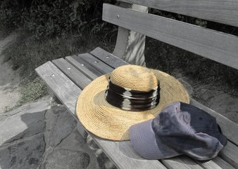 vacation hats on a beach bench