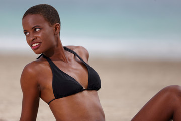 Young African American woman on the beach