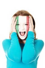 Woman with Italian flag on face.