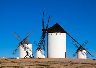 Few windmills in field