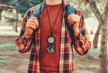 Tourist man with a compass