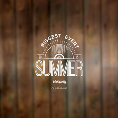 Summer biggest event label on wooden texture