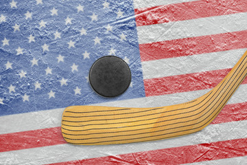 Hockey puck, stick and American flag