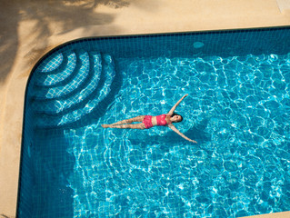 Woman Swimming and Relaxing In Pool