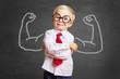 Leinwandbild Motiv Kind vor Tafel mit Muskeln aus Kreide