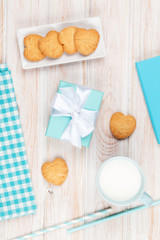 Cup of milk, heart shaped cookies, gift box and notepad